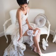 garter, hairstyle, seating, shoes, wedding dress