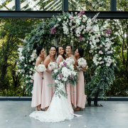 bride and bridesmaids, floral arch, floral decor