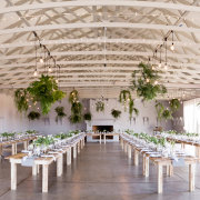 floral decor, hanging bulbs, hanging decor, lighting, table settings, venue