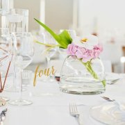 floral centrepiece, wedding stationery