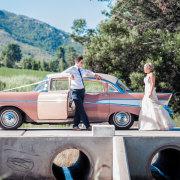 bride and groom, car