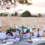 candles, floral decor, outdoor reception, outdoor wedding, table settings - Finfoot Lake Reserve