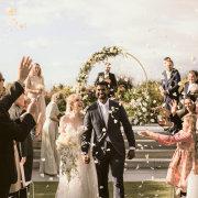 arches, bride and groom, bride and groom, bride and groom, confetti, outdoor ceremony - Cavalli Estate