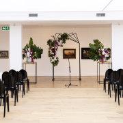 arches, floral decor, indoor ceremony - Cavalli Estate