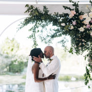 bride and groom, bride and groom, bride and groom, first kiss, floral arches - Aleit Weddings