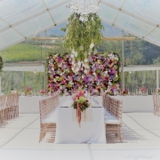 floral centrepieces, hanging decor, hanging greenery, naked bulbs, flower wall - Nicolette Weddings