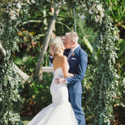 floral arch, kiss, kiss, bride and groom, bride and groom - Planned To Perfection