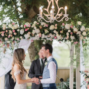 bride and groom, bride and groom, ceremony, chandeliers, floral arch - Planned To Perfection