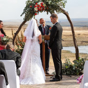 bride and groom, bride and groom, floral arch, outside ceremony - Tala Collection Private Game Reserve