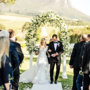 bride and groom, bride and groom, bride and groom, floral arches, outdoor ceremony - Webersburg