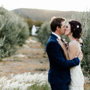 bride, groom, kiss - The Venue @ Pearl Mountain
