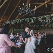 bride and groom, bride and groom, bride and groom, ceremony, first kiss, hanging greenery - Leopard Lodge