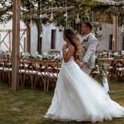 bride and groom, bride and groom, bride and groom, hanging decor, naked bulbs, outdoor reception - Boschendal