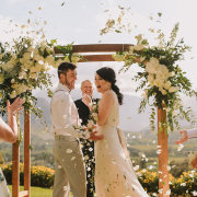 bride and groom, bride and groom, confetti, floral arch - The Event Planners