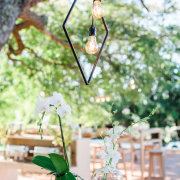 geometric hanging decor, naked bulbs - Salt & Pepper Creative