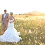 bride and groom, field, wedding dress - Barefeet Videography