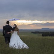 bride and groom, field, parasol