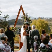 first kiss, floral arches, outdoor ceremony - Phase Events