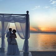 arch, beach, bride and groom