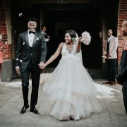 bouquets, bride and groom, bride and groom, roses, tuxedo, wedding dresses - Accolades Boutique Venue