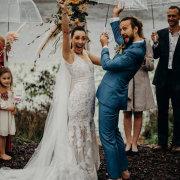 bride and groom, bride and groom, unbrellas - Makeup by Lauren