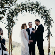 bride and groom, bride and groom, floral arch - Willie Viljoen at Cape Marriages