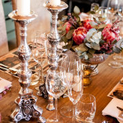 candles, flowers, glassware, protea, table setting