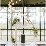 floral arches, hanging decor, naked bulbs - Whispering Thorns