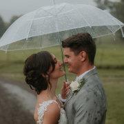 bride and groom, bride and groom, umbrealla, smiles, umbrella