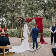 outside ceremony, wedding arch