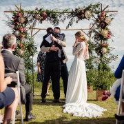 bride, floral arch, floral gazebo