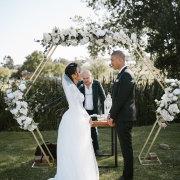 bride and groom, bride and groom, floral wedding arch