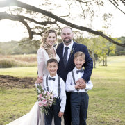 bride and groom, bride and groom, page boys, family