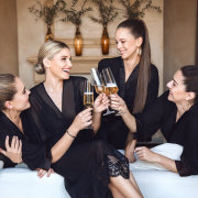bride and bridesmaids, champagne, getting ready