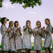 bride and bridesmaids, getting ready gowns