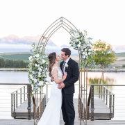 bride and groom, bride and groom, floral arch, wedding arch