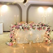 candles, floral decor, main table