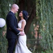 bride, groom, hanging greenery