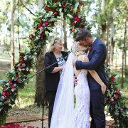 kiss, kiss, wedding arch